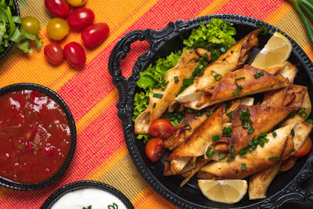 Homemade small tacos with chicken, dipping sauces and food ingredients called taquitos Stok Fotoğraf