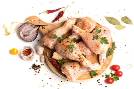 Raw chicken drumsticks with cooking ingredients on white background isolated Stok Fotoğraf
