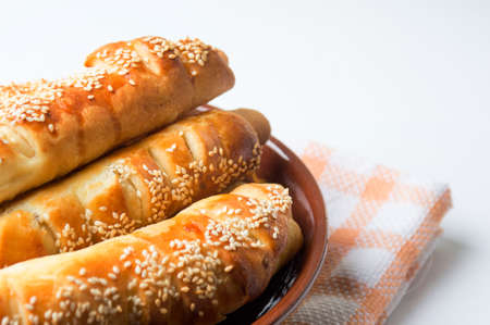 Sesame covered pastry in a bowl on white Stok Fotoğraf