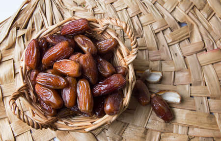 Bunch of dried date fruits in a bowl