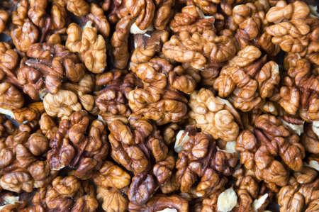 Peeled raw walnuts making a background texture
