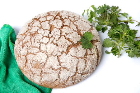 Rye bread loaf with stinging nettle leaves Stok Fotoğraf