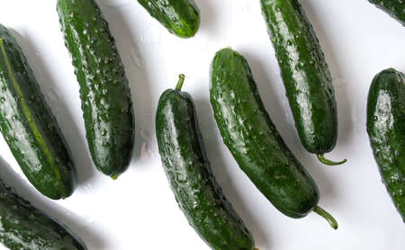 Freshly washed cucumbers on white wooden table Stok Fotoğraf