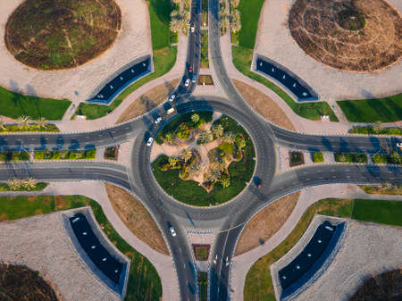 Large roundabout at Dubai Silicon Oasis in Dubai emirate suburbs at United Arab Emirates aerial top view