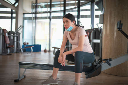 Pregnant Asian woman in the gym indoors for a fit and active lifestyle during pregnancy