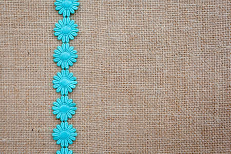 Background - burlap hessian with daisy chain pattern
