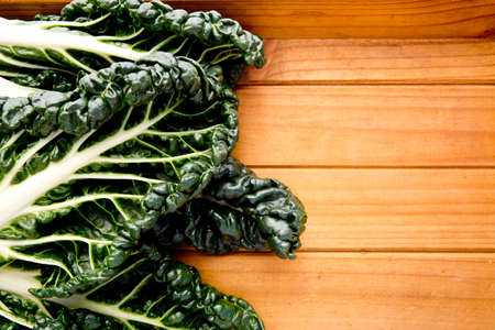 Fresh Silverbeet on wooden background