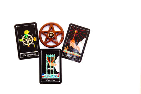 Tarot readings with deck of Tarot cards with wooden pentagram incense burner on white background