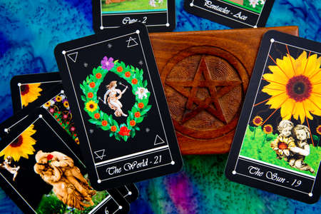 Tarot readings with deck of Tarot cards with wooden box with pentagram design Stock Photo - 80934998