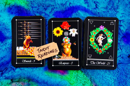 Tarot readings with deck of Tarot cards on multi colored silk reading cloth