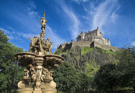 Edinburgh Castle, one of Scotlands most iconic images, viewed from Princes St Gardens on a mid-summer day.