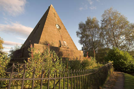 This extraordinary pyramid was built in the nineteenth century in Stirlings Valley Cemetery as a monument to the Scottish Reformation. Stock Photo