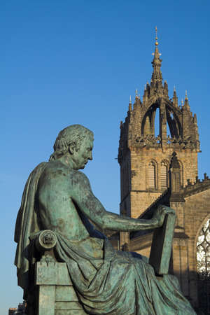 Monument to the Scottish Enlightenment philosopher David Hume on Edinburghs Royal Mile with the crown spire of St Giles Cathedral in the background. Humes radical views often brought him into conflict with the Scottish church.