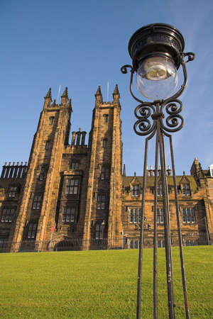 The General Assembly building on the Mound in Edinburgh with an antique streetlamp in the foreground. This is the venue for the annual meeting of the General Assembly of the Church of Scotland, the most important event in the Scottish church calendar. Stock Photo