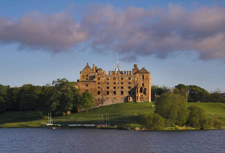 Beautifully situated by a small loch, the atmospheric ruins of Linlithgow Palace are most celebrated today as the birthplace of Mary, Queen of Scots. Stock Photo