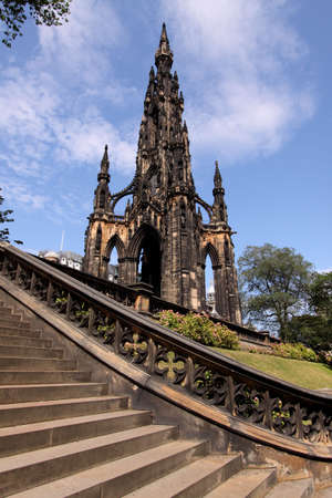 sir walter scott: The Scott Monument on Edinburghs Princes Street with a curving stairway in the foreground. Stock Photo