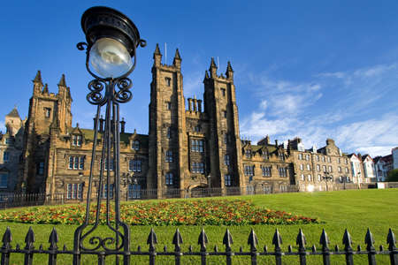 The General Assembly building on the Mound in Edinburgh with an antique streetlamp in the foreground. This is the venue for the annual meeting of the General Assembly of the Church of Scotland. Stock Photo