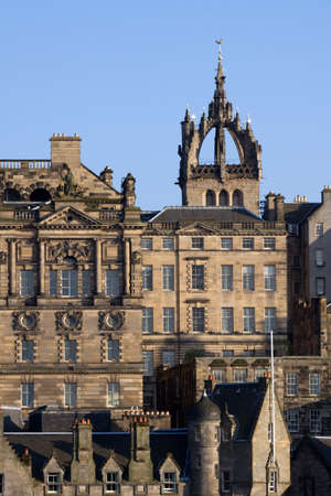 Edinburgh Old Town architecture with the crown spire of historic St Giles Cathedral visible in the background.