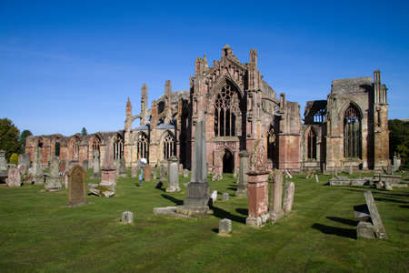 abbey: Melrose Abbey in the Scottish Borders is a beautiful and atmospheric red sandstone medieval ruin. It is also renowned as the poignant setting in which the embalmed heart of King Robert the Bruce was laid to rest.