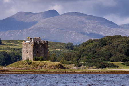 Castle Stalker is an authentic medieval tower house situated on an islet on Loch Laich on the north-west coast of Scotland amidst truly spectacular mountain scenery.