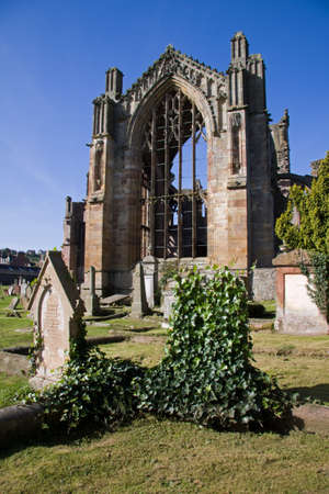 Melrose Abbey in the Scottish Borders is a beautiful and atmospheric red sandstone medieval ruin. It is also renowned as the poignant setting in which the embalmed heart of King Robert the Bruce was laid to rest. Stock Photo - 9555442