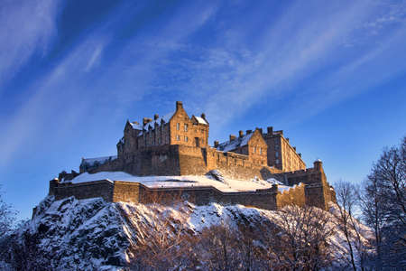wintery snowy: Edinburgh Castle In Winter Sunset