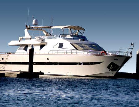 A massive super yacht, in the waters of Dubai Marina. Stock Photo