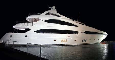 The huge 38 meter three floor luxury yacht parked in the water of Marina, Dubai.