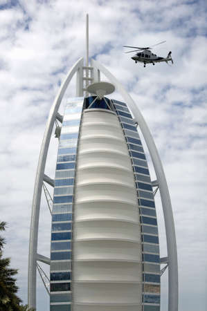 Burj Al Arab hotel one of the luxurious hotel in the world uses helicopter as taxi. One of the helicopter landing on the helipad. Editorial