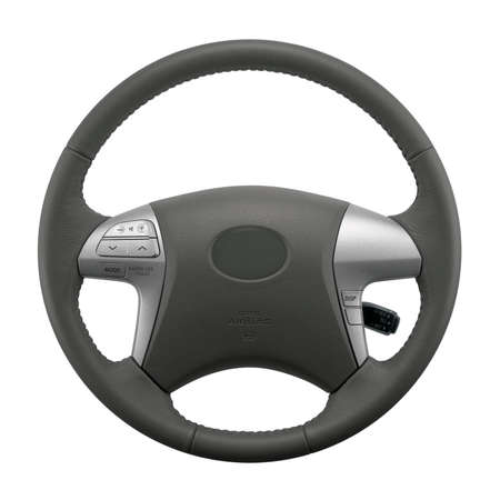 Isolated steering wheel of a car with air bag, and other controls.