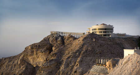 Jebel Hafeet is a mountain primarily in the United Arab Emirates on the outskirts of Al Ain. The mountain actually straddles part of the border with Oman. The mountain rises 1240 meters and offers an impressive view over the city. Jebel Hafeet was a well- Stock Photo