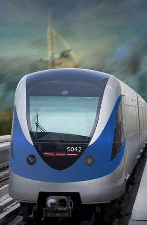 Dubai metro train arriving at the station. The image has burj al arab as background.