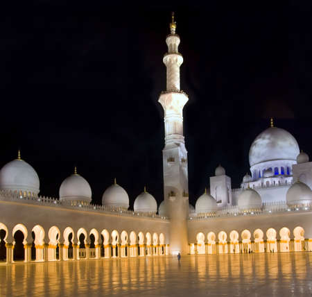 Third biggest moque in the world, located in Abu Dhabi, which is named Grand Mosque or Shiekh Zayed Mosque. The mosque is illuminated in the night. Stock Photo
