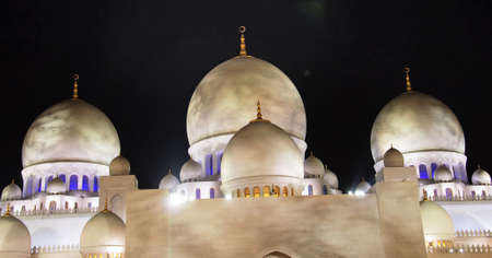 Closeup view of minarets of Sheikh Zayed Mosque which is also known as grand mosque in Abu Dhabi, UAE.