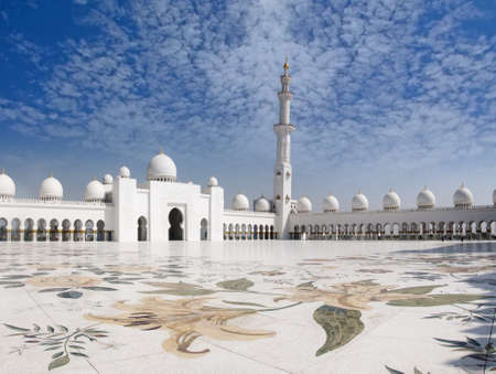 historian: Sheikh Zayed Mosque with a view of beautiful prayer veranda and lovely clouds, this is one of the largest prayer area after mecca.