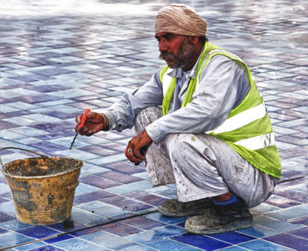 DUBAI, UAE - FEBRUARY 12: Construction worker in Dubai, the original people behind the beuatifican of Dubai. A general image of a worker in his deep thoughts in a contruction site in Dubai on 12th feb 2012.