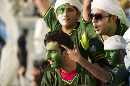 Dubai, United Arab Emirates - Nov 11: Jublient Pakistani cricket supporter with face paint cheers the team, during the 1st ODI cricket match between Pakistan and Sri Lanka on  Nov 11, 2011 at Dubai Sports City, Dubai, UAE.