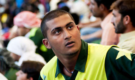 Dubai, United Arab Emirates - Nov 11: An emotional Pakistani cricket supporter looks at the huge score board details, during the 1st ODI cricket match between Pakistan and Sri Lanka on  Nov 11, 2011 at Dubai Sports City, Dubai, UAE.
