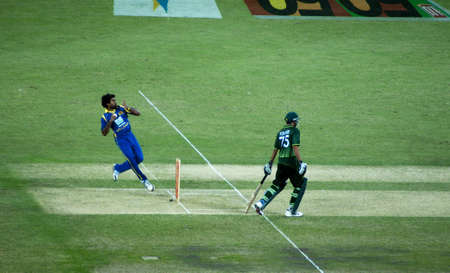 Dubai; United Arab Emirates - Nov 11: Sri Lankas fast bolwer Separamadu Lasith Malinga in action during the 1st ODI cricket match between Pakistan and Sri Lanka on; Nov 11; 2011 at Dubai Sports City; Dubai; UAE. While Pakistani cricketer batsman Younus K Editorial