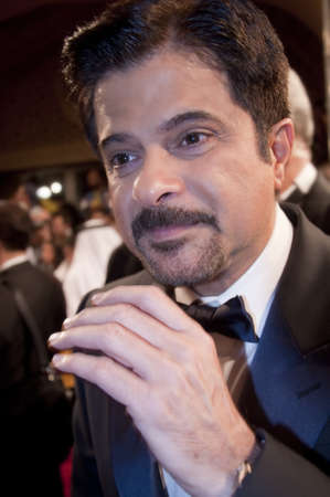 Dubai - UAE - December 2011: Anil Kapoor greets fans as he arrives at the opening ceremony for