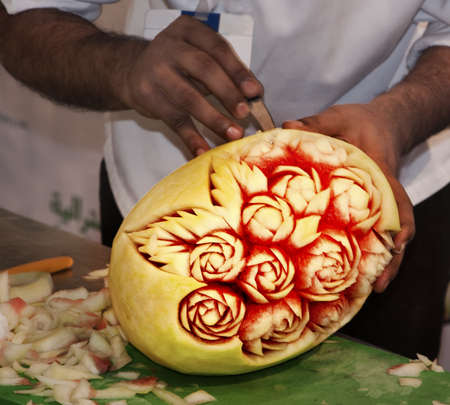 A chef in action carving the water melon, duing the Gulf Food Festival in Dubai.