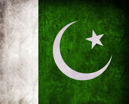 Pakistan Flag with grunge and retro effect on a wall