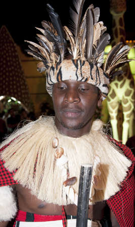 DUBAI, UAE - FEBRUARY 18 2010: Unidentifed African Tribe with ethnic and tribal coustume posing during 16th Dubai Shopping Festival Carnival at Global Village on Feb 18, 2010 in Dubai.  Editorial