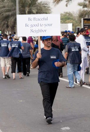 DUBAI - UAE - APRIL 06 2012: Unidentified person with a placard during the March For Peace event organized by Dubai Islamic Department and Govt. of Dubai on April 06 2012 in Zabeel, Dubai.