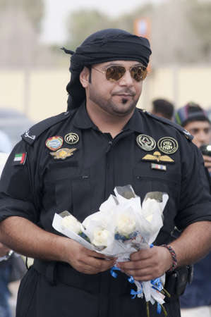 DUBAI - UAE - APRIL 06 2012: Abu Dhabi's Top Police Officer distributing white roses during the