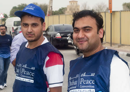 DUBAI - UAE - APRIL 06 2012: Two participants during the March For Peace event organized by Dubai Islamic Department and Govt. of Dubai on April 06 2012 in Zabeel, Dubai.