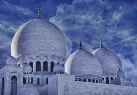religious building: The exterior and domes of world famous landmark Sultan Sheikh Zayed Mosque in Abu Dhabi, UAE  Considered as 8th largest mosque in the world