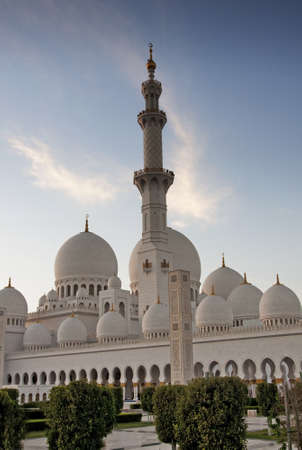 The exterior and minaret of world famous landmark Sultan Sheikh Zayed Mosque in Abu Dhabi, UAE  Considered as 8th largest mosque in the world