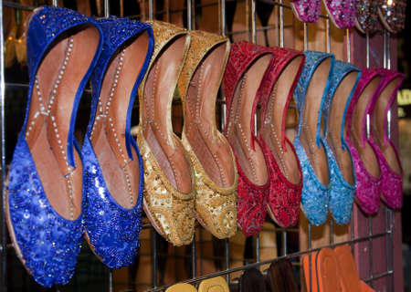 A collection of colorful Indian and Pakistani style ladies sandal displayed in a market place
