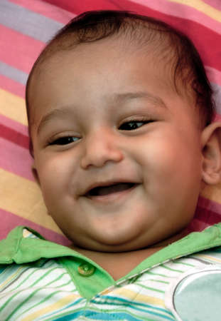 Young new born Indian baby boy smiling